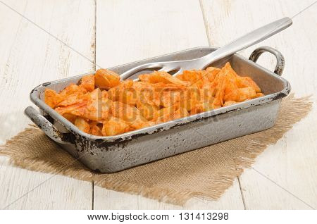 potato and pasta with sunflower oil and paprika powder hungarian meal in a baking tin