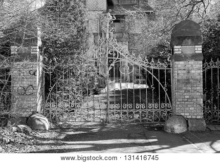 Gate of the hunting lodge in Jelenia Gora, Silesia, Poland - black and white