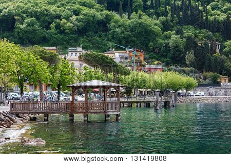 Garda Italy - May 03 2016: Wooden rotunda on the shore of Lake Garda