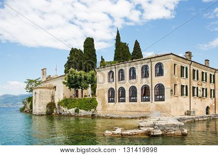 Saint Vigilio Italy - May 03 2016: View of the famous house on the shore of Lake Garda from bay