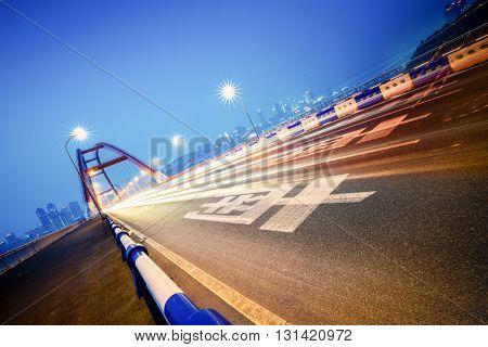 traffic trails at caiyuanba yangtze river bridge,chongqing china.