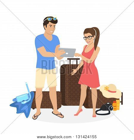 Young couple standing near luggage and using tablet pc to watch photos from their holiday or they are planning to travel and choosing the resort or hotel on tablet pc. People isolated on white