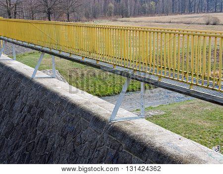 Yellow bridge on a reservoir dam in Silesia, Poland
