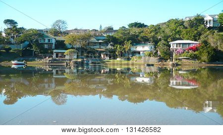 Reflections on a calm Gonubie river East London South Africa