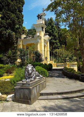 gazebo and a statue of a lion in the  parkland among the trees, Sochi city