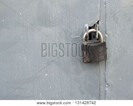 protection: lock at a dirty metal door