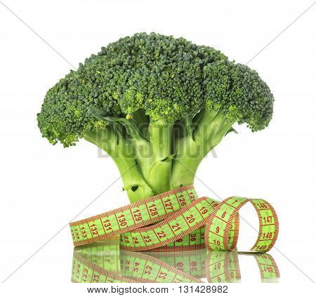 Broccoli and centimeter closeup isolated on white background concept of healthy eating and weight loss
