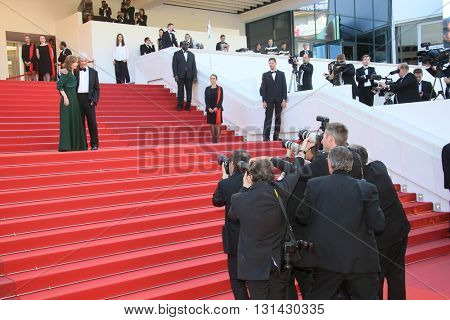 CANNES, FRANCE - MAY 21:  Isabelle Huppert and director Paul Verhoeven attend the 'Elle' Premiere during the 69th annual Cannes  Festival at the Palais des Festivals on May 21, 2016 in Cannes, France.