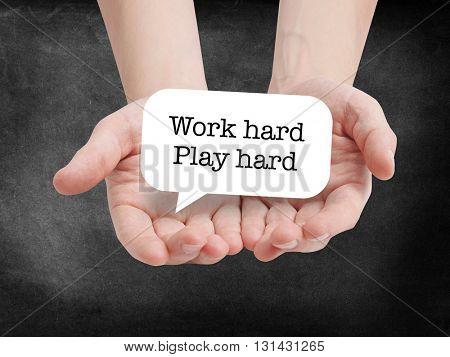 Work hard play hard written on a speechbubble