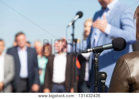 Businessman or politician is giving a speech. Press conference.