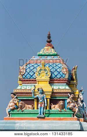 Chettinad India - October 16 2013: Short Vimanam on Ayyanar shrine at entrance of Kadiapatti village. The village protector is pictured together with horse and lions.