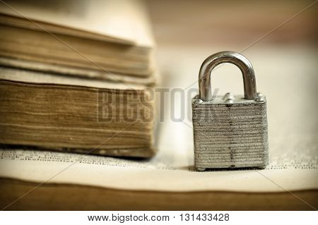 A padlock on an old book - solution wisdom concept