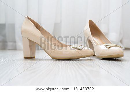 A Beautiful beige women shoes on the floor