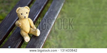 Website banner of a toy bear as giving his paw - hope concept
