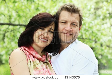 Portrait of a happy married couple outdoor.