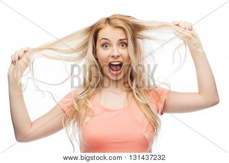 hair care, hairstyle and people concept - young woman or teenage girl holding strand of her hair