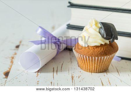 Graduation concept - cupcake with academic cap, copy space