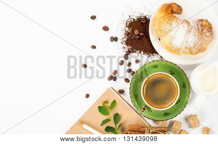 traditional breakfast with fresh croissants and coffee on white background