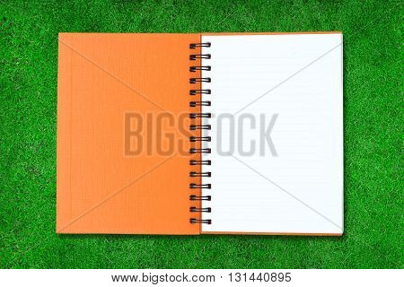 Orange note book on white color background