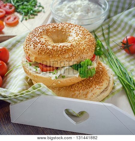 Bagels sandwiches wtih cream cheese tomatoes and chives healthy vegetarian breakfast. Summer picnic set. Fresh snack.
