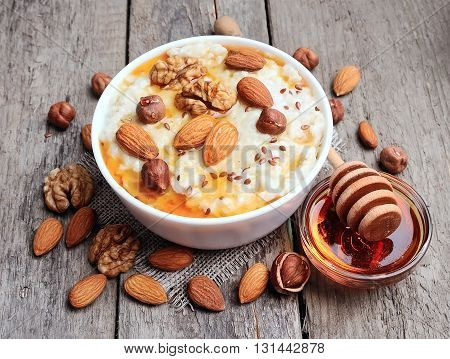Porridge oats with mix nuts and honey on wooden tables