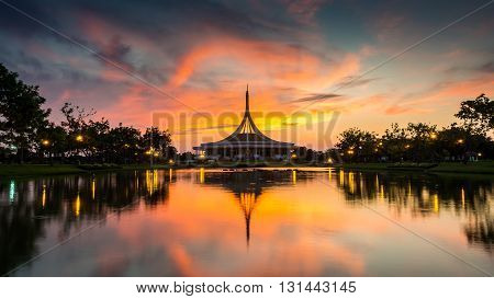 Beautiful sunset at the public park Suan Luang Rama IX. Ratchamangkhala pavillion and reflection in twilight time