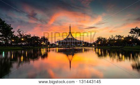 Beautiful sunset at the public park Suan Luang Rama IX. Ratchamangkhala pavillion and reflection in twilight time