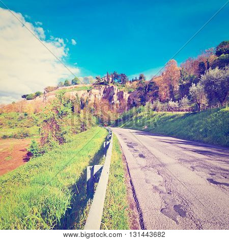 Winding Asphalt Road between Spring Fields in Tuscany Retro Effect