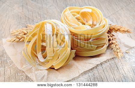 Freshly prepared fettuccine pasta closeup. Pasta tagliatelle with wheat.