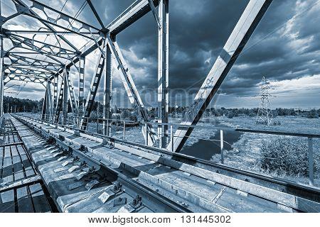 Railway bridge under the dramatic stormy skies.