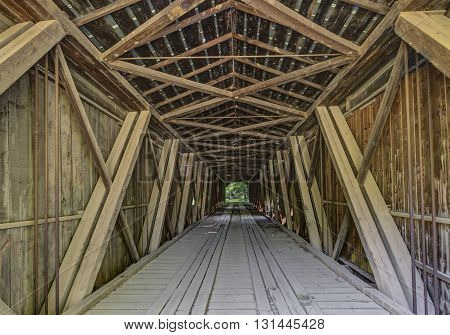 A look inside Fountain County Indiana's Cades Mill Covered Bridge reveals this antebellum landmark's Howe through truss design.