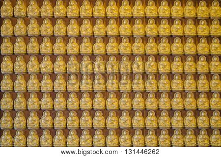 Buddha series on the wall in Thai temple at Bangkok Thailand