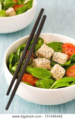 Vegan tofu salad with tomatoes and lamb's lettuce