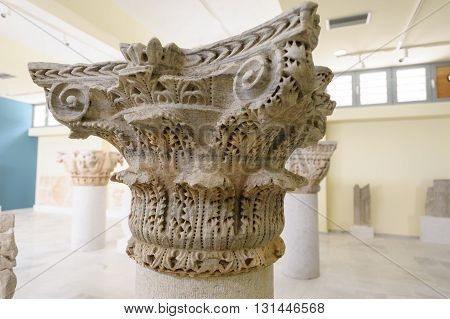 KRINIDES GREECE - FEBRUARY 25 2010: Detail of a marble Byzantine column capital in Corinthian order at Philippi