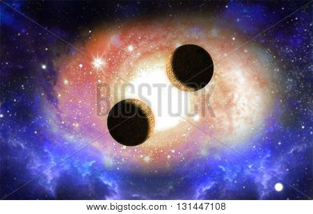 Two planets with galaxy and light effect