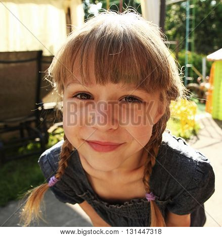 a very beautiful little girl in nature