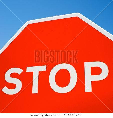Stop traffic sign with clear blue sky.