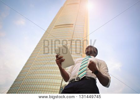 Young businessman in a sunny day