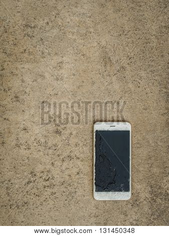 Top View of Crack Screen Smart Phone on the Floor with Copy Space