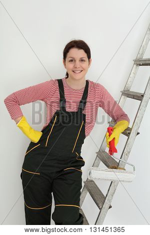 Young Smiling Worker Paint A Room