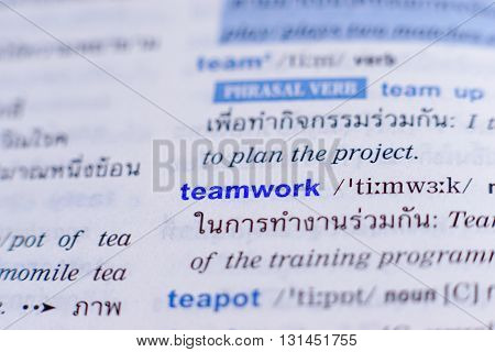 dictionary page with word teamwork highlighted in blue