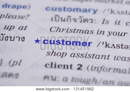 dictionary page with word customer highlighted in blue