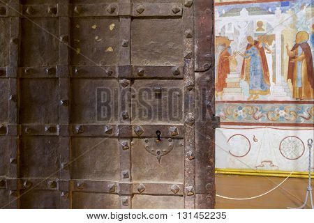 ROSROV RUSSIA - JUNE 3 2013: Rostov Kremlin. This is ancient metal doors leading into the church decorated with frescoes transitions between the churches.