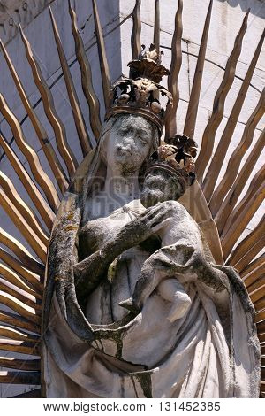 LUCCA, ITALY - JUNE 06, 2015: Virgin Mary sculpture with Jesus on the corner of the facade of the San Michele in Foro Church in Lucca, Italy, on June 06, 2015