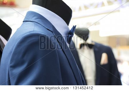 Elegant suit for special occasions on a mannequin in a shop