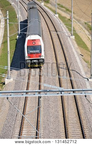 Dolny Hricov, Slovakia - April 30, 2016: Passenger train which had had the departure from Zilina in motion on electric railway above view