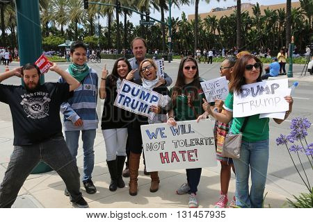 Protesters yell argue with supporters waves signs and cause trouble for the police at the Republican Presidential  Candidate Donald J. Trump rally. 5.25.2016