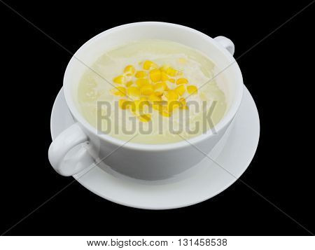 Corn cream soup isolated on the black background with clipping path