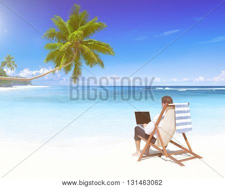 Businessman working on a tropical beach.