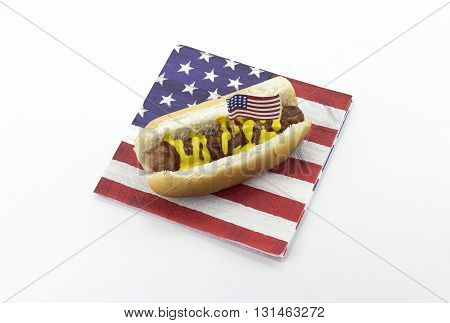 Hotdog on an American flag napkin and toothpick